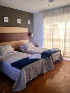 A bed or beds in a room at MIRAFLORES PENTHOUSE FOR 13, 5 Rooms/4 baths - Excelent Location