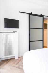 TV o dispositivi per l'intrattenimento presso Maison BON Apartment