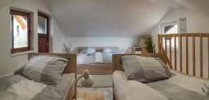 A bed or beds in a room at Apartma PEPI