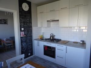 A kitchen or kitchenette at Zenhouse