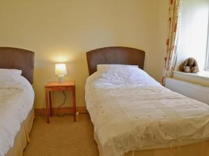 A bed or beds in a room at Pheasant Lodge