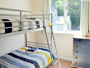 A bunk bed or bunk beds in a room at Acorns