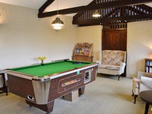 A pool table at Elm