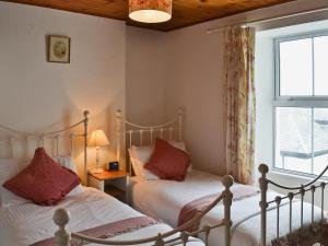 A bed or beds in a room at West Pentire House