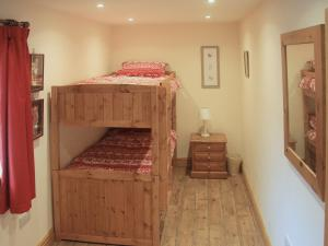 A bunk bed or bunk beds in a room at Peggy'S Barn