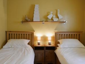 A bed or beds in a room at High Moor Cottage