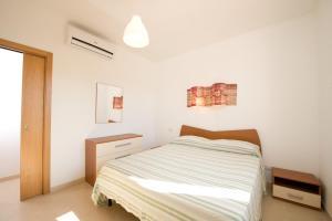 Postel nebo postele na pokoji v ubytování A Borgo Frigole