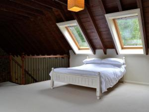 A bed or beds in a room at The Steading