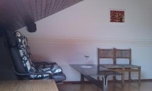 A seating area at Sound Apartma Eva
