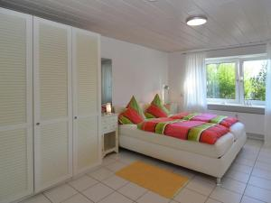 A bed or beds in a room at Relax