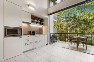 A kitchen or kitchenette at Peppers Noosa Resort and Villas