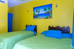 A bed or beds in a room at Dreams Negril Rooms