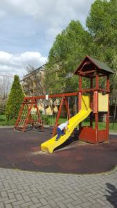 Children's play area at Ligetház Apartman