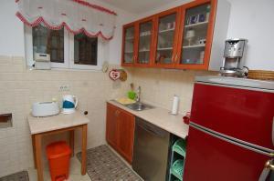 A kitchen or kitchenette at Uvala Apartment