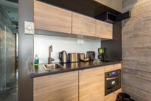 A kitchen or kitchenette at CMG Suite Premium Tour Eiffel III