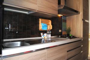 A kitchen or kitchenette at Ferrarin Apartment