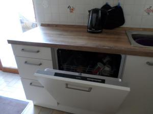 A kitchen or kitchenette at Appartement Eurométropole Strasbourg Tout confort