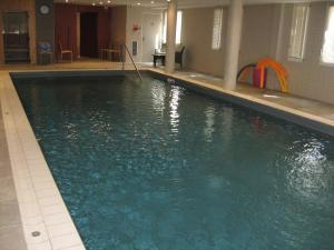 The swimming pool at or near Domitys Le Parc Balsan