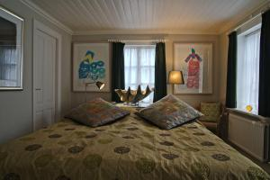 A bed or beds in a room at Art Centrum Apartments
