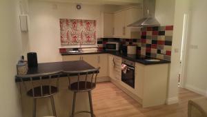 Una cocina o zona de cocina en Two Moors Retreat