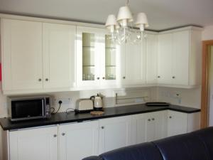 A kitchen or kitchenette at Apt 13 The Waterfront