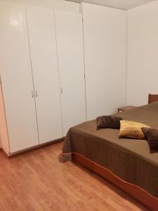 Vuode tai vuoteita majoituspaikassa Apartments in Finland N & P
