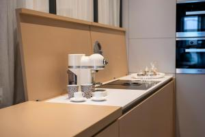 A kitchen or kitchenette at Cinquanta4 Charme Apartment
