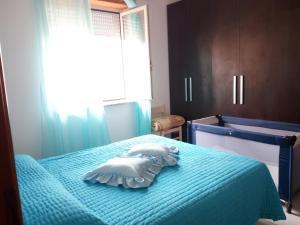 A bed or beds in a room at La Mia Vacanza a Bosa Marina