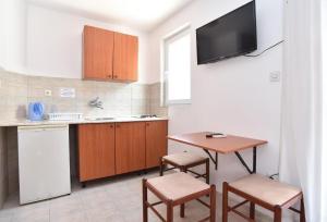 Кухня или мини-кухня в Apartmani Alexandra