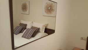 A bed or beds in a room at PureHome Islantilla