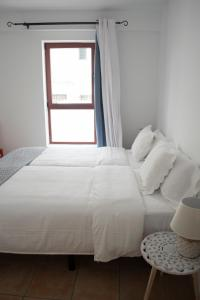 A bed or beds in a room at Corralejo Center, by Comfortable Luxury