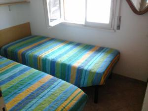 A bed or beds in a room at village CAMPO DEL SOLE
