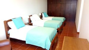 A bed or beds in a room at Vivenda Cabral