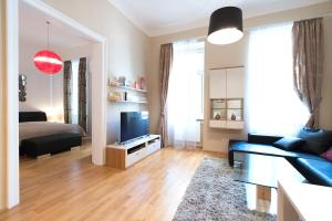 A television and/or entertainment center at Anna Maria Apartments in Vienna Citycenter
