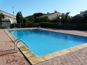 The swimming pool at or near Le Hameau du Rivage 224