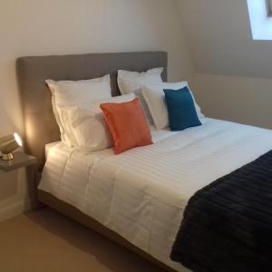 Tempat tidur dalam kamar di Villa Louise