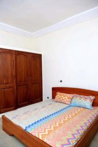 A bed or beds in a room at Appartement Ridwan-Lahi