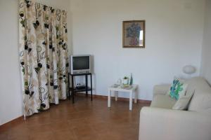 A seating area at Casa Vacanze Il Gelsomino
