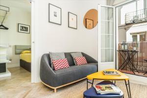 A seating area at BNBHolder Charming & Stylish CHUECA