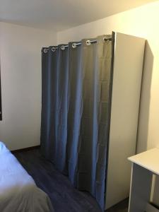Un ou plusieurs lits dans un hébergement de l'établissement Appartement St Timothée