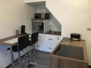 Cuisine ou kitchenette dans l'établissement Appartement St Timothée