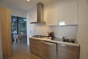 A kitchen or kitchenette at La Casa Dell'Etna