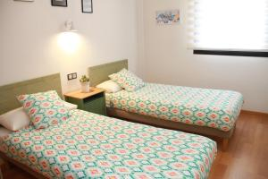 A bed or beds in a room at Teatro Cervantes SigloXXI
