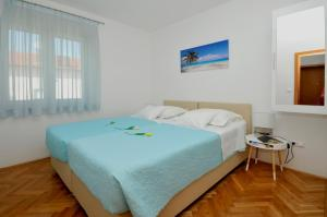 A bed or beds in a room at Apartmani Trogir
