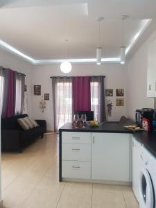 A kitchen or kitchenette at Charalambous Apartment