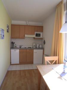 A kitchen or kitchenette at Haus Strandperle
