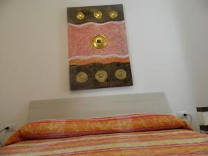 A bed or beds in a room at Vecchia Riva