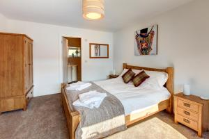 Taylor Cottage tesisinde bir odada yatak veya yataklar