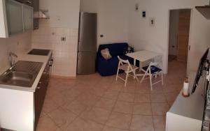 Kuchyňa alebo kuchynka v ubytovaní Šukalo