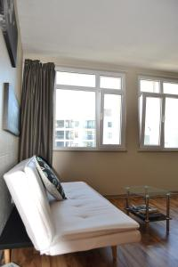 A bed or beds in a room at Central Upper Long St Apartment